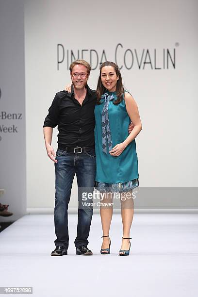 Fashion designers Ricardo Covalin and Cristina Pineda walk the runway during the first day of MercedesBenz Fashion Week México Autumn/Winter 2015 at...