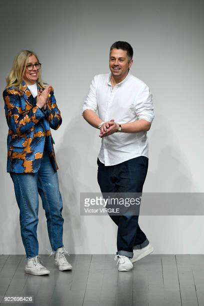 Fashion designers Rob Jones and Cat Teatum walk the runway at the Teatum Jones Ready to Wear Fall/Winter 20182019 fashion show during London Fashion...