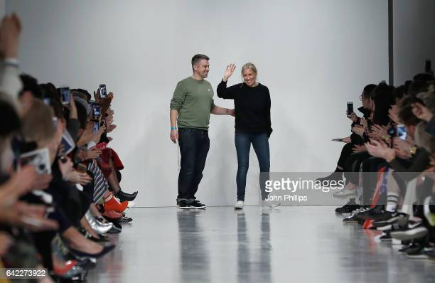 Fashion designers Rob Jones and Catherine Teatum on the runway after their show during the London Fashion Week February 2017 collections on February...