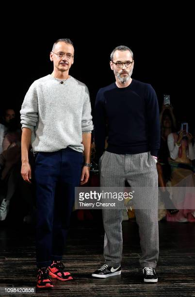 Fashion designers Rolf Snoeren and Viktor Horsting acknowledge the audience at the end of the Viktor & Rolf Spring Summer 2019 show as part of Paris...