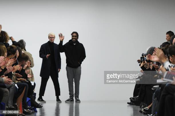 Fashion designers Sam Cotton and Agi Mdumulla acknowledge the applause of the audience after the Agi & Sam show during The London Collections: Men...