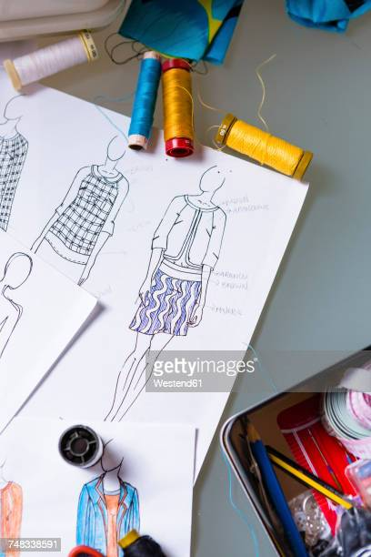 Fashion designer's sketches on a working table