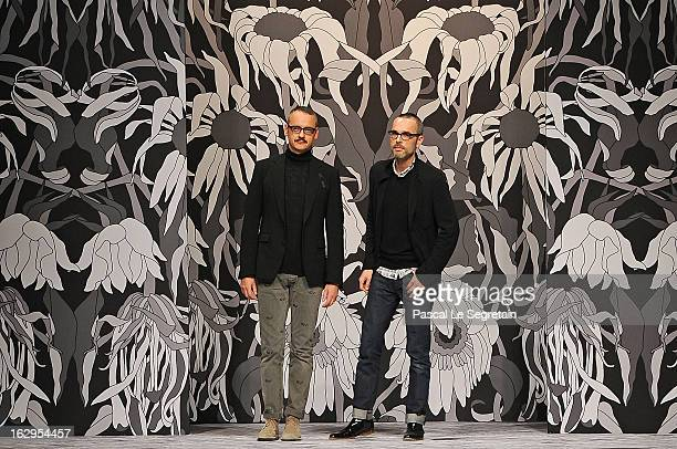 Fashion designers Viktor Horsting and Rolf Snoeren acknowledge applause following the ViktorRolf Fall/Winter 2013 ReadytoWear show as part of Paris...