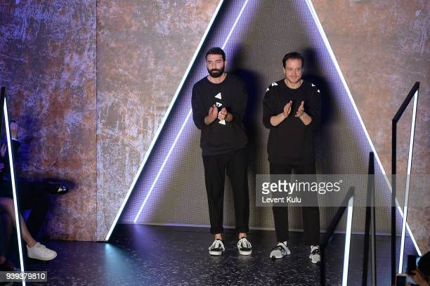Fashion designers Volkan Guzelce and Koray Avci walk the runway after their Brand Who show during Mercedes Benz Fashion Week Istanbul at Zorlu...