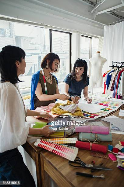 Fashion designers working in studio