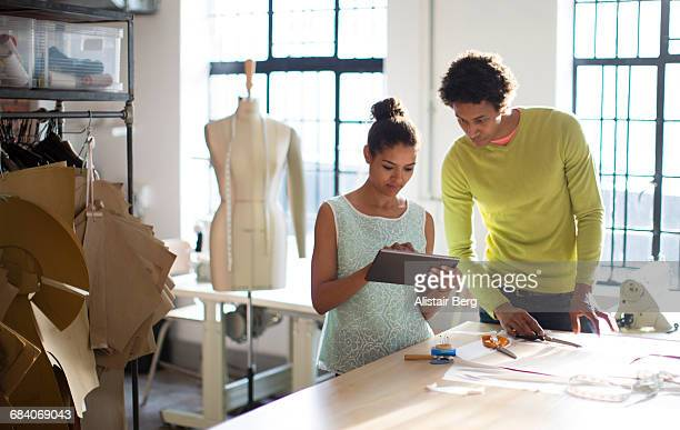fashion designers working together in their studio - hi tech moda stock pictures, royalty-free photos & images