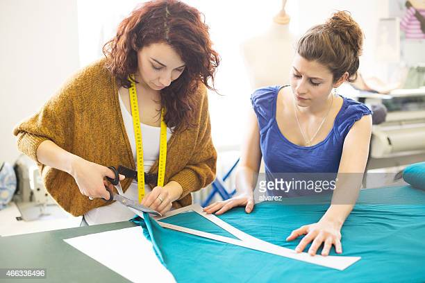 Fashion designers working together on new dress design