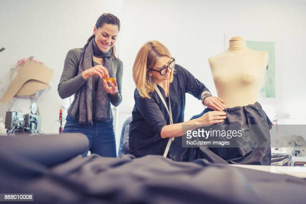 Fashion designers working together.