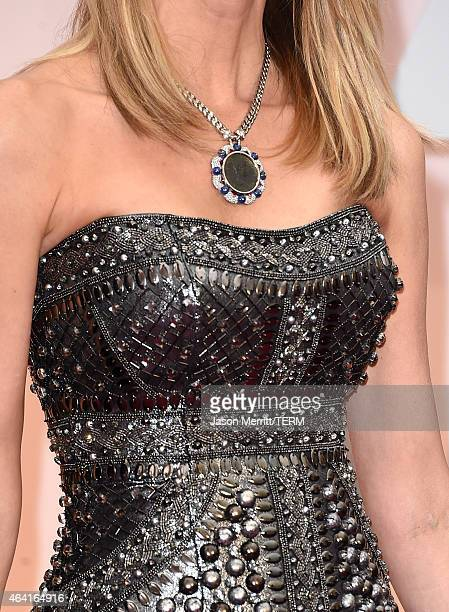 Fashion detail Best Supporting Actress nominee Laura Dern at the Oscars Red Carpet wearing turquoise jewelry in support of American Lung...