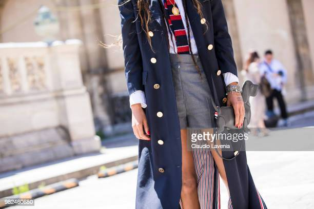 Fashion detail of Adesuwa Aighewi Thom Browne bag is seen in the streets of Paris before the Thom Browne show during Paris Men's Fashion Week...