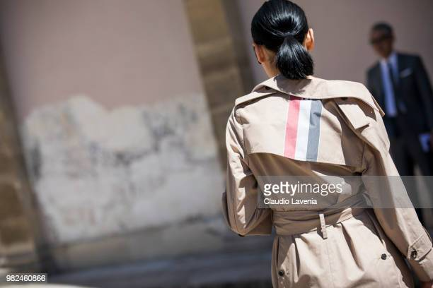 Fashion detail of Amalie Gassmann Thom Browne trench coat is seen in the streets of Paris before the Thom Browne show during Paris Men's Fashion Week...