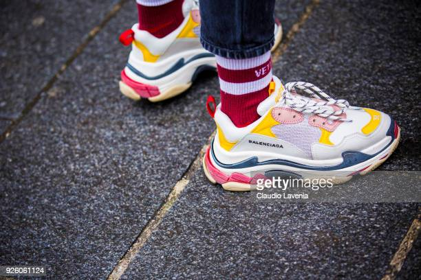 Fashion detail of Balenciaga sneakers is seen in the streets of Paris before the Ann Demeulemeester show during Paris Fashion Week Womenswear...