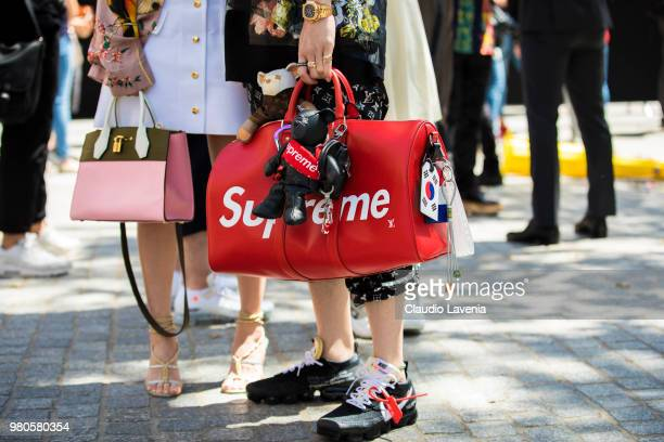 Fashion detail of Supreme red bag is seen in the streets of Paris before the Louis Vuitton show during Paris Men's Fashion Week Spring/Summer 2019 on...