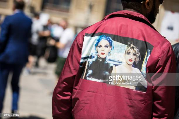 Fashion detail of Supreme red bomber jacket is seen in the streets of Paris before the Thom Browne show during Paris Men's Fashion Week Spring/Summer...