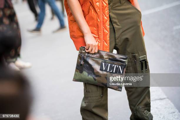 Fashion detail of Valentino camouflage hand bag is seen in the streets of Paris after the Valentino show during Paris Men's Fashion Week...