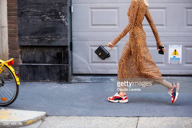 Fashion details of Adidas sneakers and black bag wearing is seen before the Blumarine show during Milan Fashion Week Spring/Summer 2019 on September...