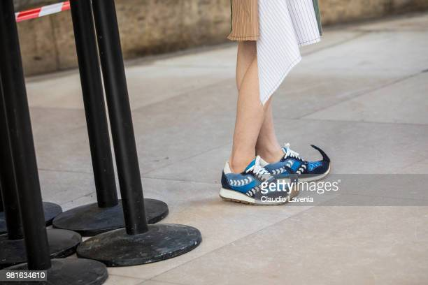 Fashion details of Loewe shoes is seen in the streets of Paris before the JuunJ show during Paris Men's Fashion Week Spring/Summer 2019 on June 22...