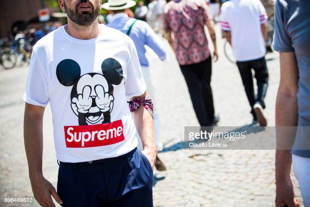 Fashion details of Supreme tshirt is seen during Pitti Immagine Uomo 92 at Fortezza Da Basso on June 15 2017 in Florence Italy