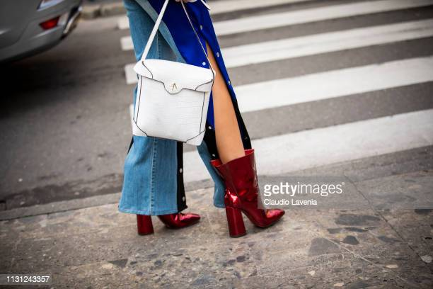 Fashion details of white bag and red boots are seen outside Max Mara on Day 2 Milan Fashion Week Autumn/Winter 2019/20 on February 21, 2019 in Milan,...