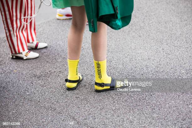 Fashion details of yellow socks and black sandals are seen in the streets of Paris after the Y3 show during Paris Men's Fashion Week Spring/Summer...