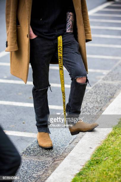 Fashion details Off White belt and brown boots are seen outside Giorgio Armani show during Milan Fashion Week Fall/Winter 2018/19 on February 24 2018...