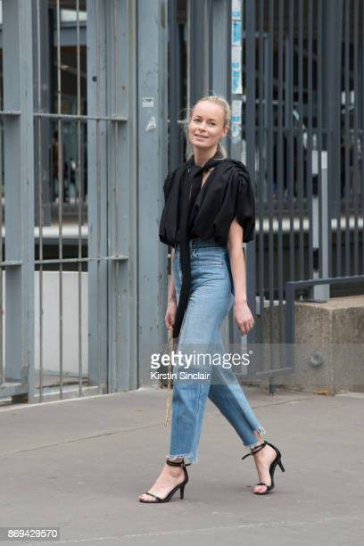 Fashion Director at Costume Magazine Denmark Thora Valdimars wears a Jacquemus top Vetements jeans HM shoes and a Marc Jacobs bag day 3 of Paris...