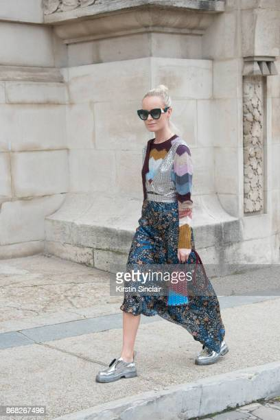 Fashion Director at Costume Magazine Denmark Thora Valdimarsdottir wears a Paco Rabanne top skirt shoes and bag Marc Jacobs sweater and Fendi...