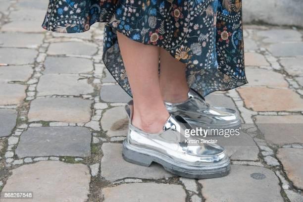 Fashion Director at Costume Magazine Denmark Thora Valdimarsdottir wears a Paco Rabanne skirt and shoes day 3 of Paris Womens Fashion Week...