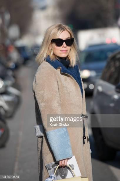 Fashion director at Elle Denmark Josephine Aarkrogh wears a Sakks Potts coat Alice Barbierday 3 of Paris Womens Fashion Week Spring/Summer 2018 on...