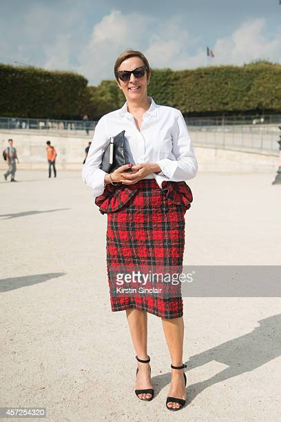 Fashion Director at Elle UK AnneMarie Curtis is wearing a Simone Rochas skirt Made in Heaven top Prada bag and Karen Walker sunglasses on day 8 of...
