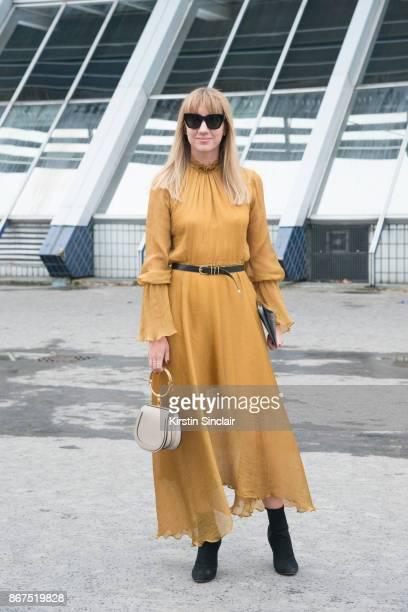 Fashion director at NetAPorter Lisa Aiken wears a Beaufille dress Chloe bag Kaibosh sunglasses and Alaïa boots day 3 of Paris Womens Fashion Week...
