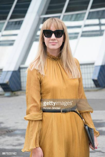 Fashion director at NetAPorter Lisa Aiken wears a Beaufille dress Kaibosh sunglasses day 3 of Paris Womens Fashion Week Spring/Summer 2018 on...