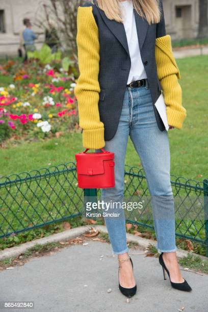 Fashion director at NetAPorter Lisa Aiken wears a Calvin Klein jacket RE/DONE jeans Gianvito Rossi shoes Nico Giani bag and Kenneth Jay Lane ankle...