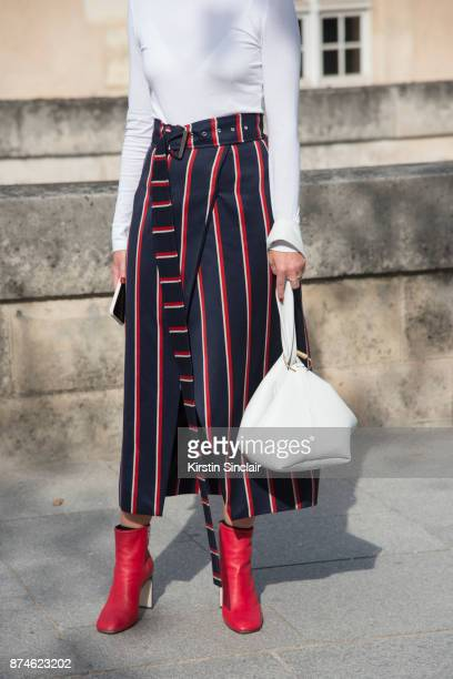 Fashion Director at NetAPorter Lisa Aiken wears a Calvin Klein sweater Solace skirt Rag Bone boots Victoria Beckham bag day 4 of Paris Womens Fashion...