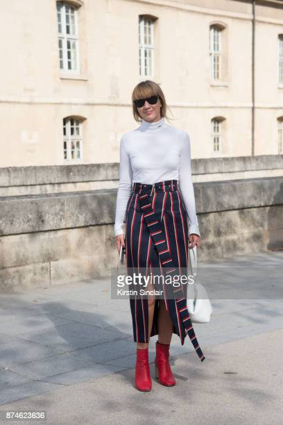 Fashion Director at NetAPorter Lisa Aiken wears a Calvin Klein sweater Solace skirt Rag Bone boots Victoria Beckham bag and Ray ban sunglasses day 4...