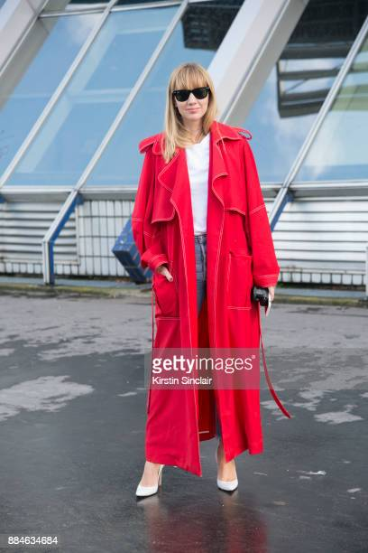 Fashion Director at NetAPorter Lisa Aiken wears a Michael Lo Sordo trench coat Ray Ban sunglasses Gianvito Rossi shoes Shopredone jeans day 5 of...