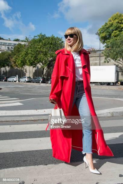 Fashion Director at NetAPorter Lisa Aiken wears a Michael Lo Sordo trench coat Yuzefi bag Ray Ban sunglasses Gianvito Rossi shoes Shopredone jeans...