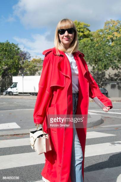 Fashion Director at NetAPorter Lisa Aiken wears a Michael Lo Sordo trench coat Yuzefi bag Ray Ban sunglasses Shopredone jeans day 5 of Paris Womens...