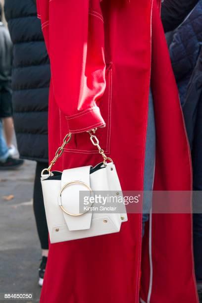 Fashion Director at NetAPorter Lisa Aiken wears a Michael Lo Sordo trench coat Yuzefi bag day 5 of Paris Womens Fashion Week Spring/Summer 2018 on...