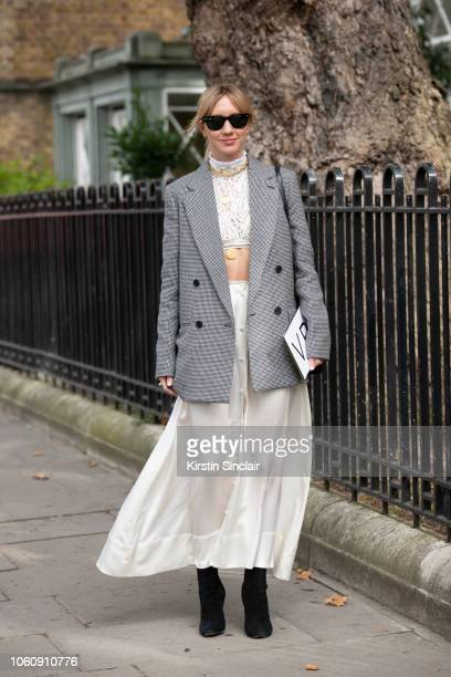Fashion Director at Netaporter Lisa Aiken wears a Stella McCartney blazer Deitas skirt Chloe top Ray Ban sunglasses Alaia boots and Devonwood Hill...