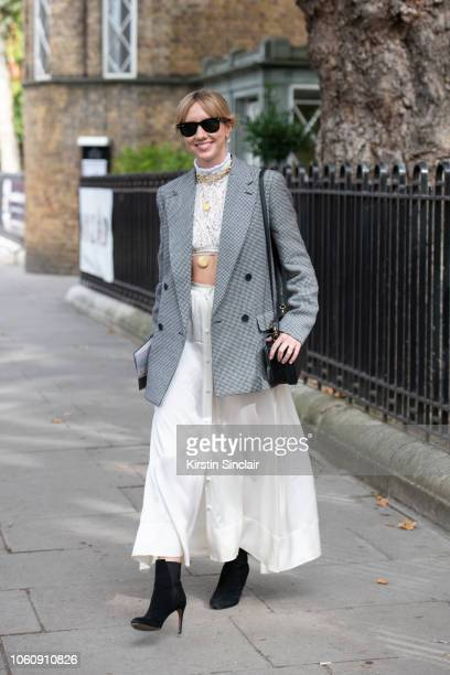 Fashion Director at Netaporter Lisa Aiken wears a Stella McCartney blazer Deitas skirt Chloe top Ray Ban sunglasses Alaia boots and Devonwood Hill...