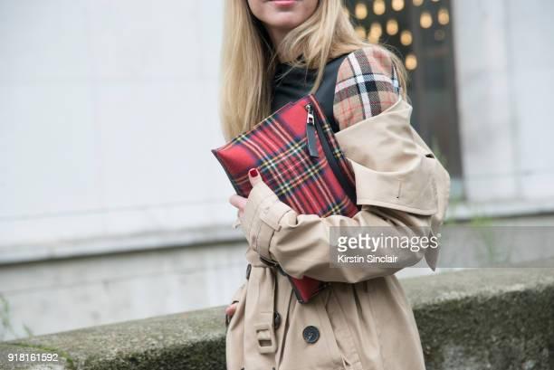 Fashion Director at NetAPorter Lisa Aiken wears an Awake coat and Loewe a bag and dress day 6 of Paris Womens Fashion Week Spring/Summer 2018 on...