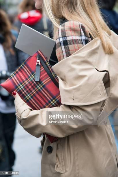 Fashion Director at NetAPorter Lisa Aiken wears an Awake coat and a Loewe and dress bag day 6 of Paris Womens Fashion Week Spring/Summer 2018 on...