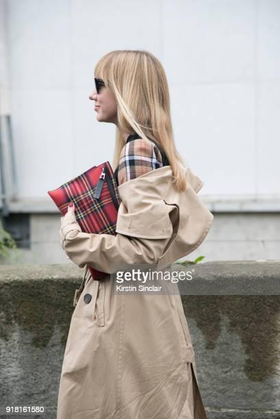 Fashion Director at NetAPorter Lisa Aiken wears an Awake coat and Loewe bag and dress day 6 of Paris Womens Fashion Week Spring/Summer 2018 on...
