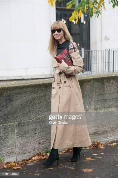 Fashion Director at NetAPorter Lisa Aiken wears an Awake coat Ray Ban sunglasses Azzedine Alaïa shoes and a Loewe bag and dress day 6 of Paris Womens...