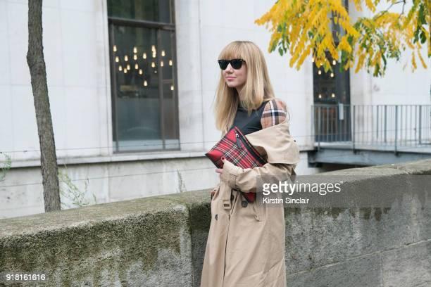 Fashion Director at NetAPorter Lisa Aiken wears an Awake coat Ray Ban sunglasses and a Loewe bag and dress day 6 of Paris Womens Fashion Week...