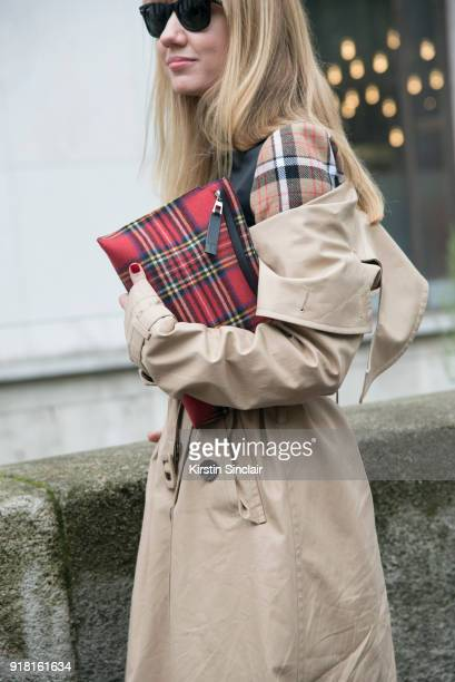 Fashion Director at NetAPorter Lisa Aiken wears an Awake coat Ray Ban sunglasses and Loewe bag and dress day 6 of Paris Womens Fashion Week...