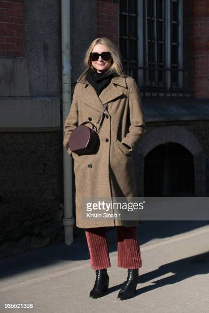 Fashion Director at The Sunday Times Jane McFarland wears a Margaret Howell coat Bertoni bag Saint Laurent boots and sunglasses day 3 of Paris Womens...