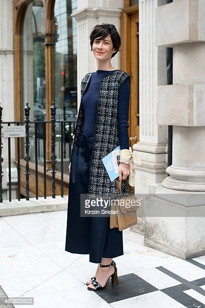 Fashion Director at Velour Violaine Bernard wears Marni shoes vintage bag Topshop trousers Zara top and Terra New York waistcoat on day 2 of London...