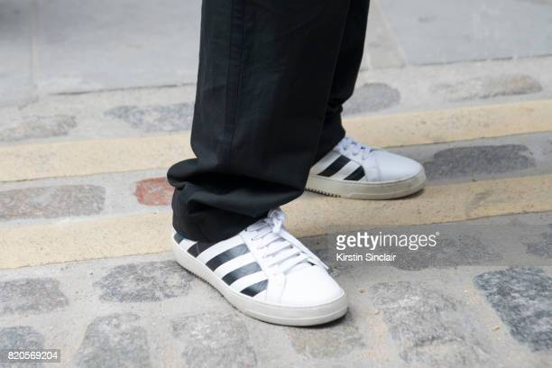 Fashion Director at WWD Alex Badia wears Off White trainers on day 3 of London Collections Men on June 11 2017 in Paris France